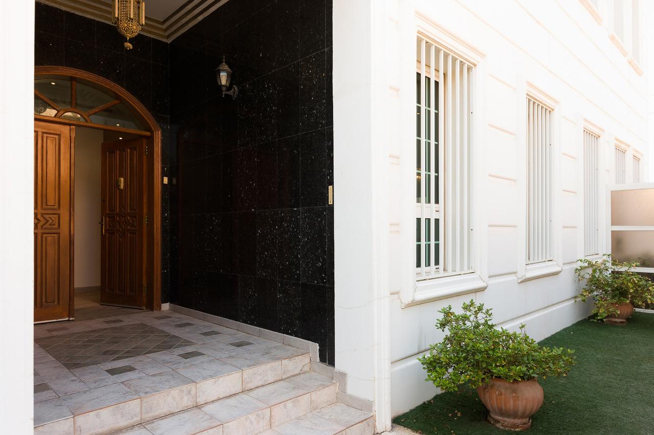 Salwa – older, spacious, unfurnished, five bedroom floor w/yard