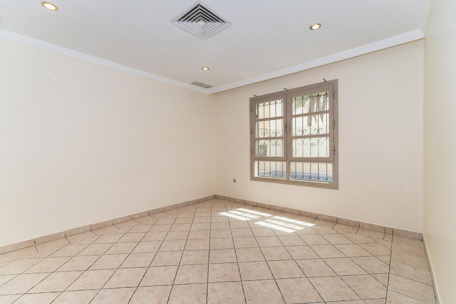 Salwa – older, unfurnished, three bedroom apartment w/small pool