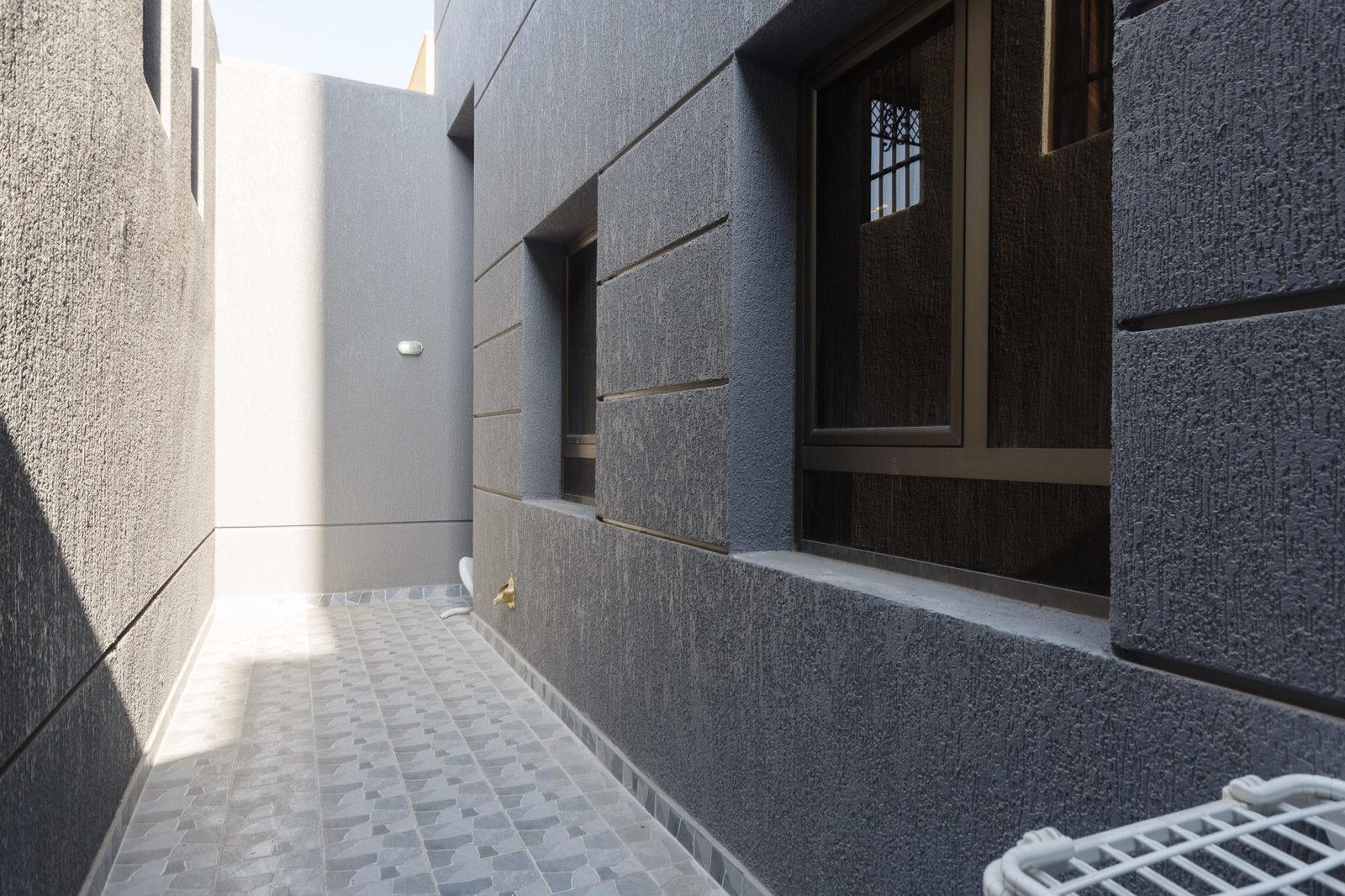 Salwa – unfurnished, three bedroom basement apartment w/yard
