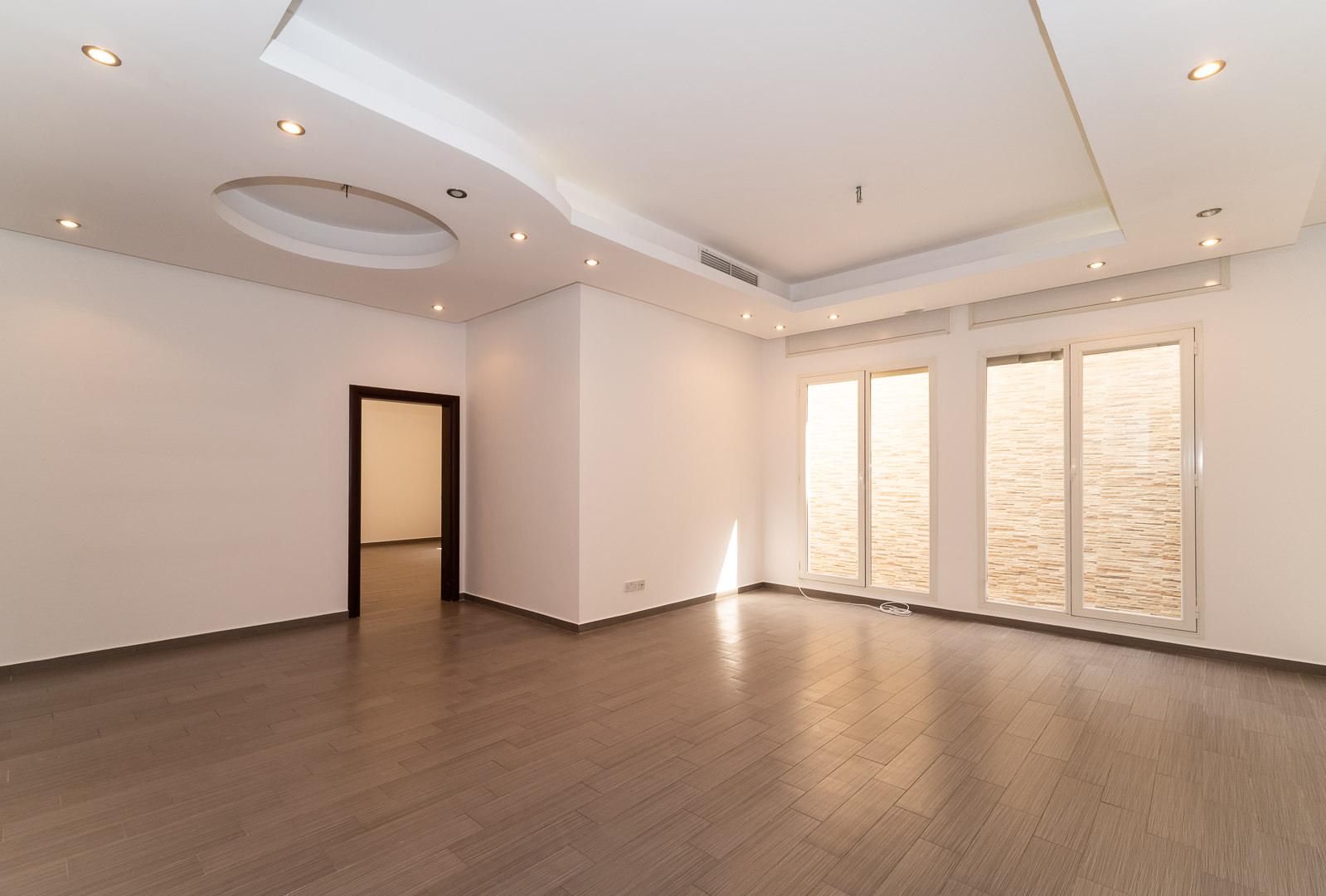 Rumaithiya – unfurnished, three bedroom ground floor w/small yard