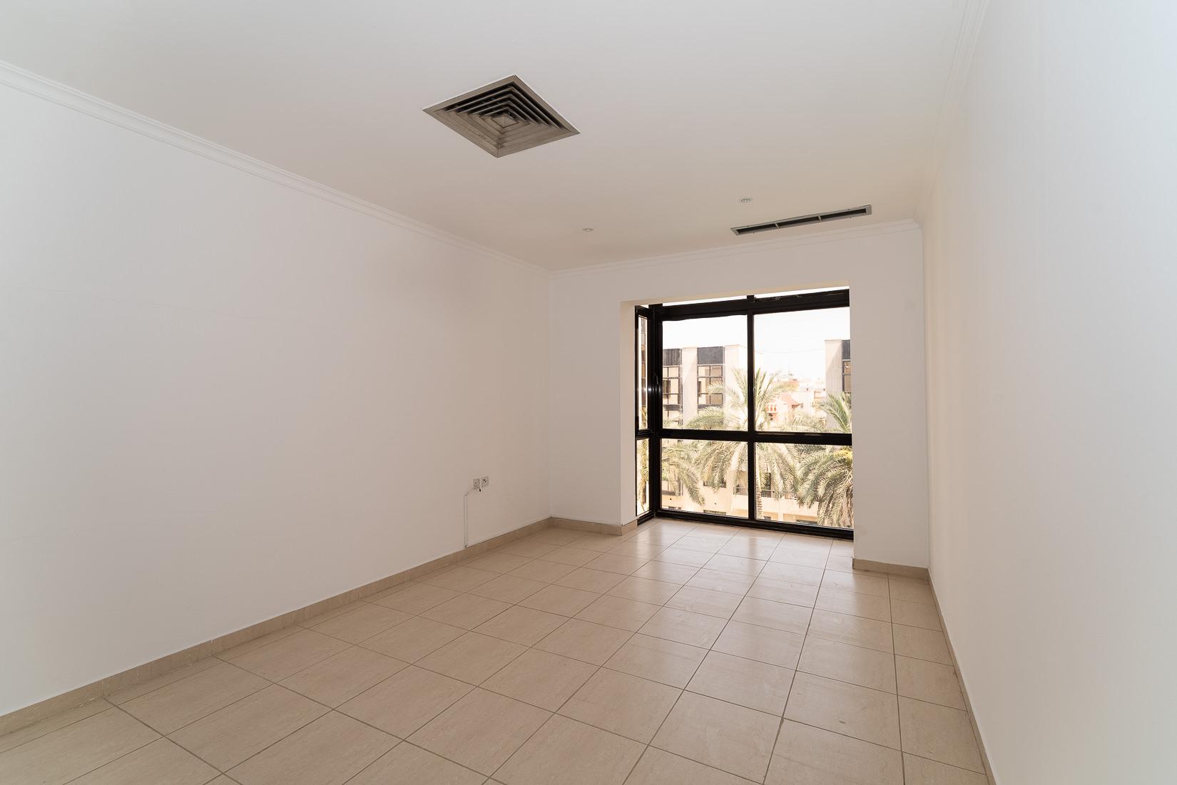 Jabriya – older, unfurnished, two bedroom apartment w/pool