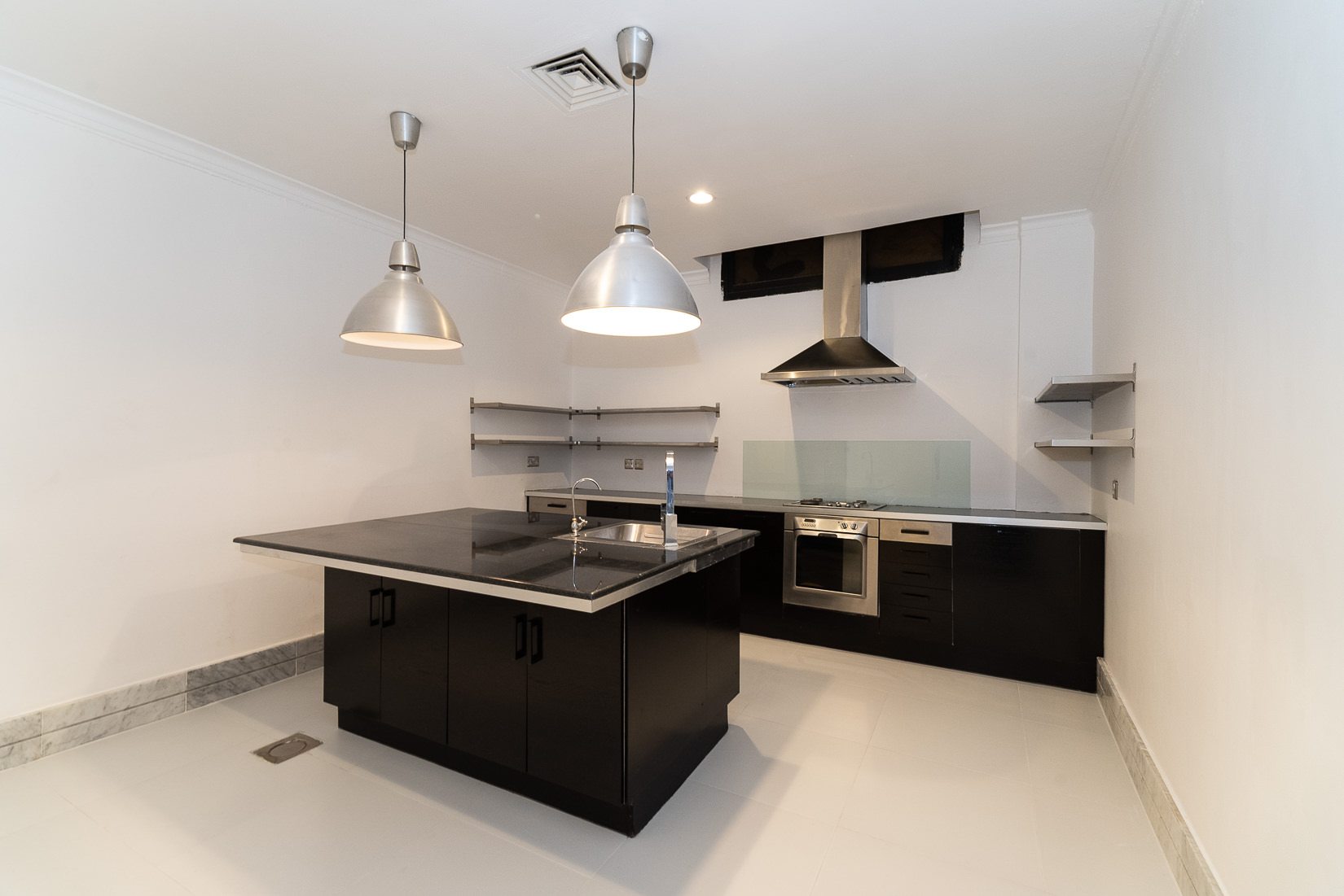Jabriya – older, renovated basement apartment w/yard