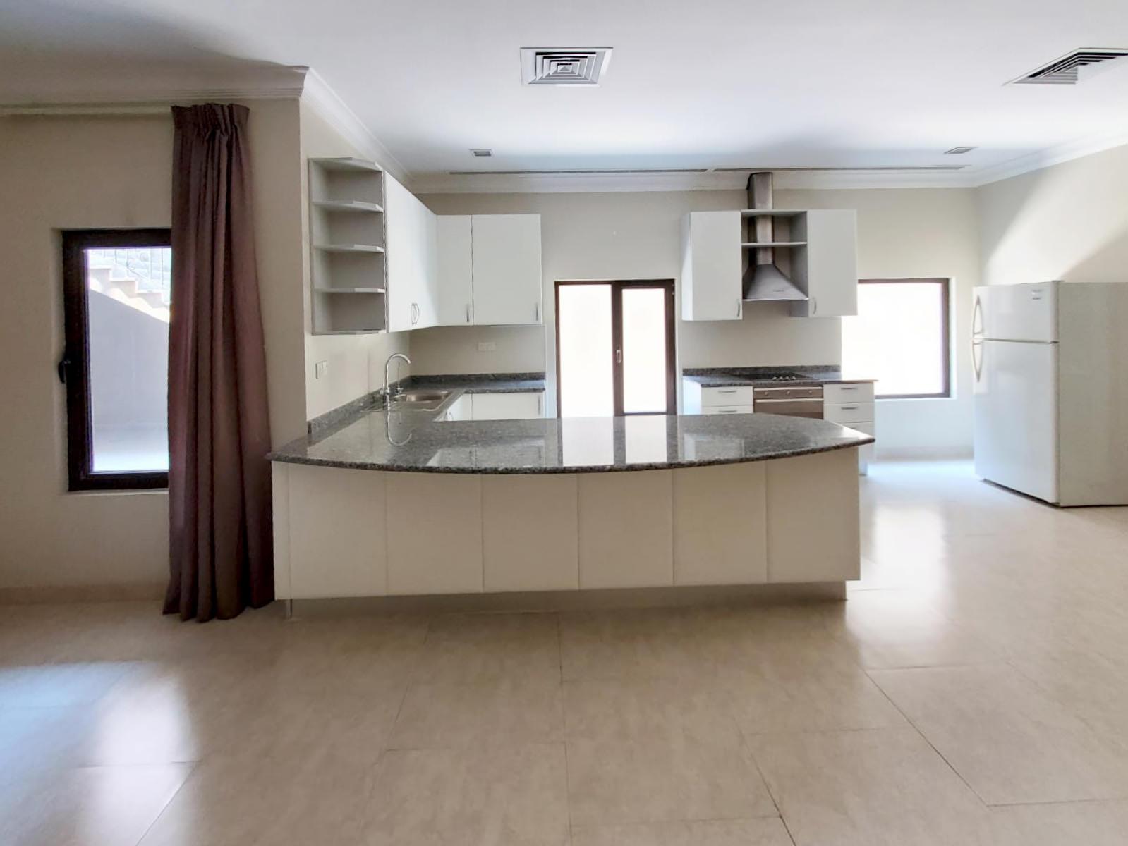 Rumaithiya -unfurnished, light basement apartment w/yard