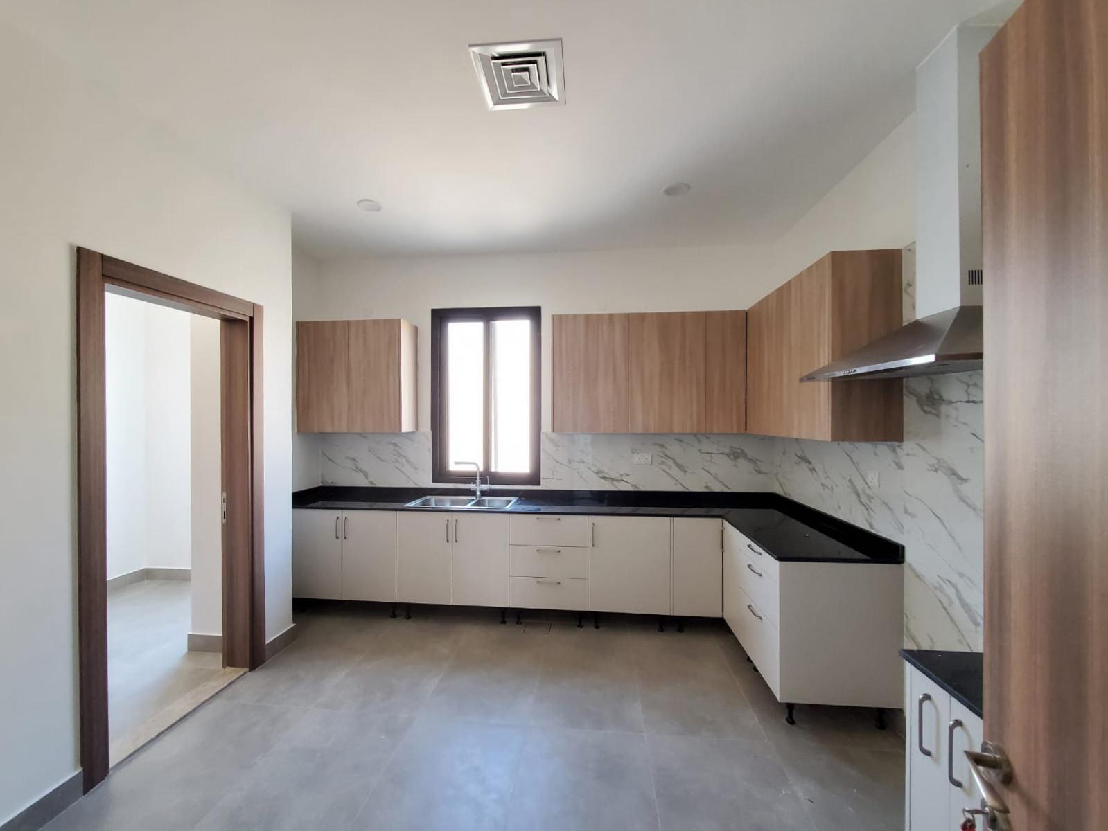 Jabriya – new,big, unfurnished, three bedrooms apartment.