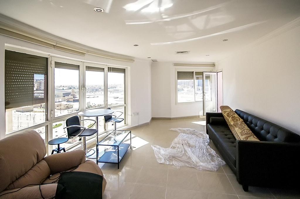 Salmiya – partially furnished, three bedroom apartment w/balcony