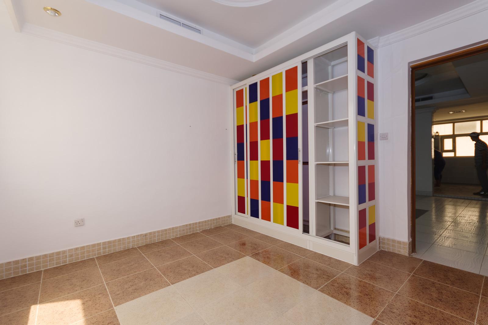 Salwa – older, unfurnished, four bedroom apartment