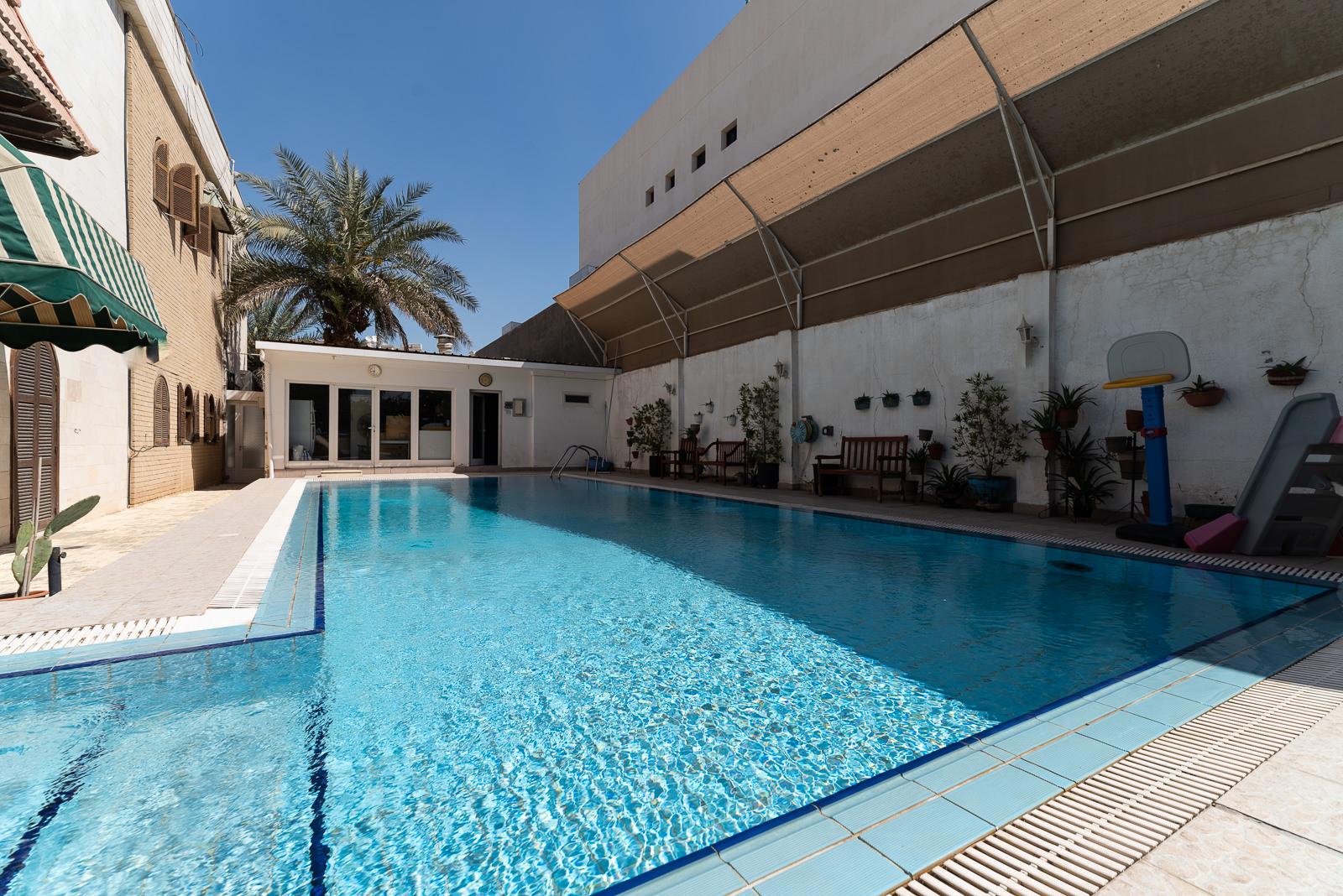 Khaldiya – semi furnished, two bedroom ground floor apartment